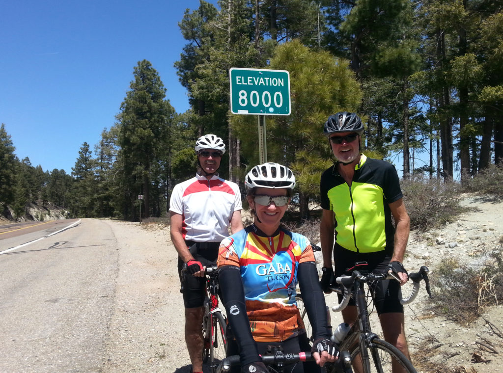 Kathleen Bober, Brian and Dave cycling on Mt. Lemmon Highway, elevation 8000 feet